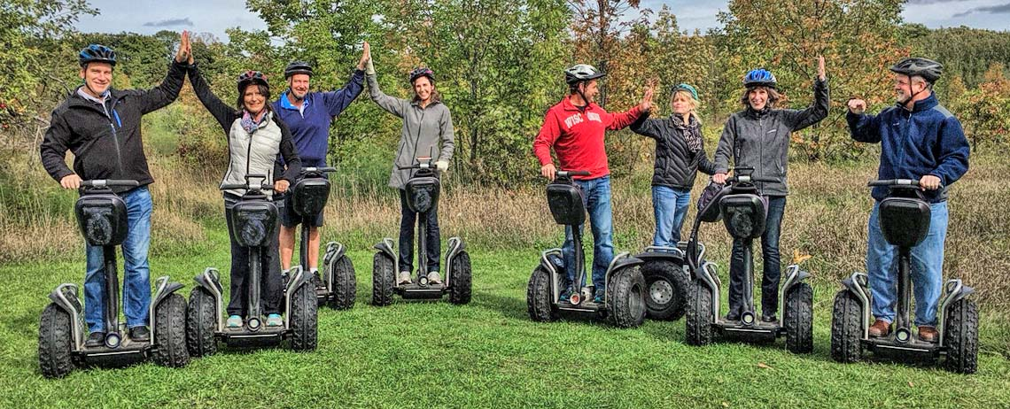 Energetic group taking a Door County Off-Road Segway Tour by Seaquist Tours